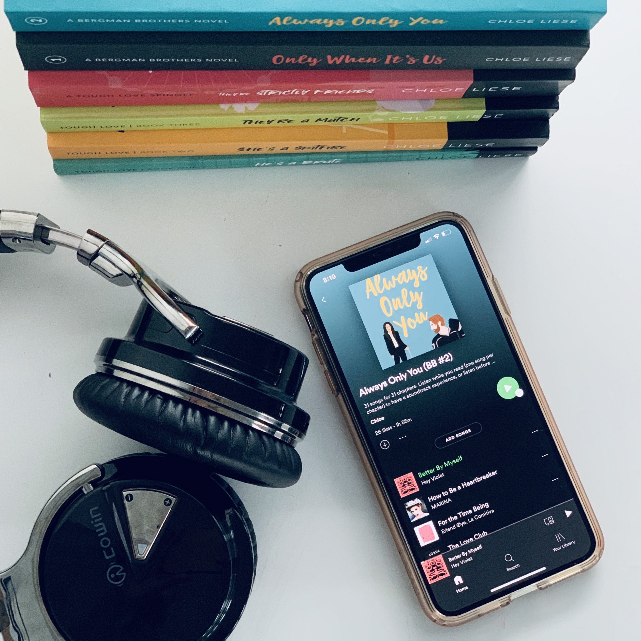 Chloe Liese book covers with iphone and earbuds